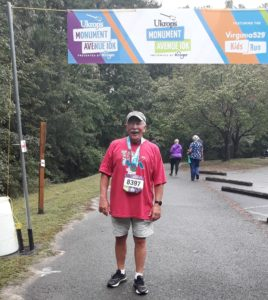 Larry Bayer standing at the finish line